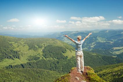Freedom Concept - Lady on Mountain Peak